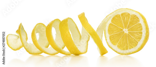 The lemon skin is twisted in a spiral with reflection on an isolated white background - 274887052