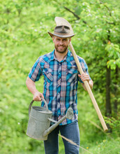 Tree Planting Tradition. Growing Plants. Mature Guy Cowboy Hat With Watering Can And Shovel. Arbor Day. Planting Trees. Commitment And Responsibilities. Agriculture Concept. Planting In Garden