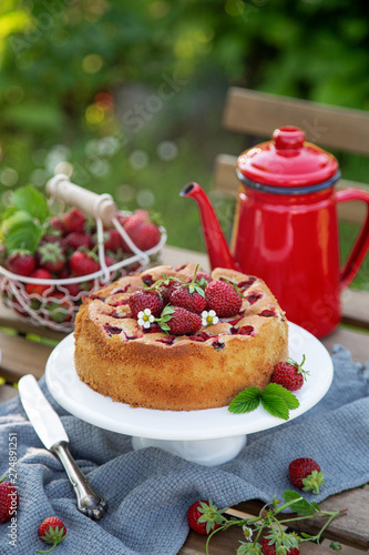 cake with fresh strawberry on wooden table, outdoor Canvas Print