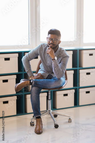 Fabulous Young Indian Man Sitting In Chair In His Modern Office Buy Pdpeps Interior Chair Design Pdpepsorg