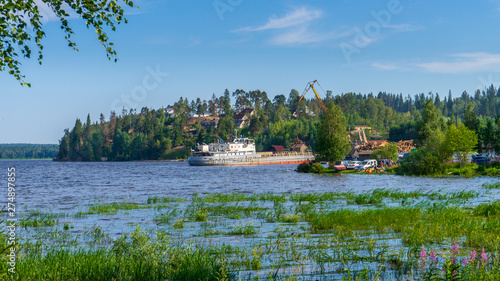 Fototapeta Summer landscape with pier and small harbour in northern village