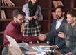 handshake of creative partners in the design Studio