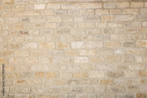 Foto auf Gartenposter Ziegelmauer Old beige brick wall background texture close up