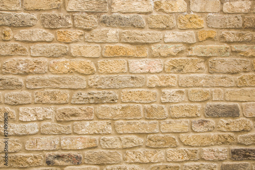 Door stickers Brick wall Old beige brick wall background texture close up
