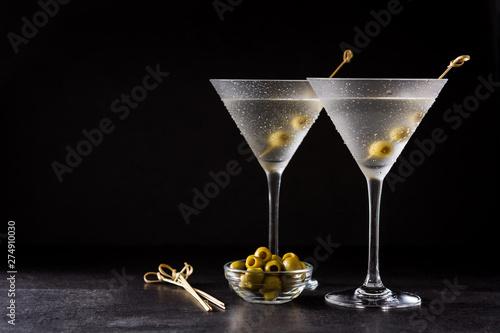 Fototapeta Classic Dry Martini with olives on black background. Copyspace obraz