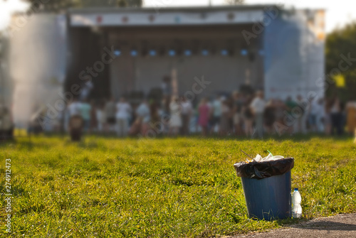 Blue litter on green grass. Garbage in the nature after the concert. - 274912473