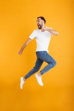 Full Length Photo Of Masculine Caucasian Man Having Beard Smiling And Running