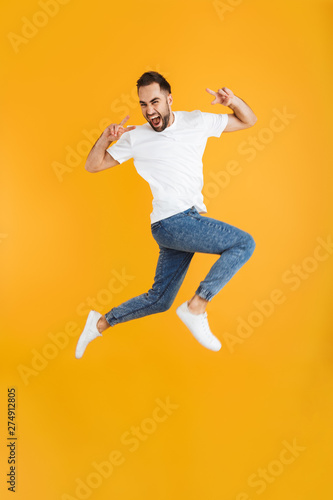 Fototapety, obrazy: Full length photo of cheerful caucasian man having beard taking selfie on cellphone and showing peace sign