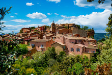 Roussillon, Small Provensal Town With  Large Ochre Deposits, Located Within Borders Of Natural Regional Park Of Luberon