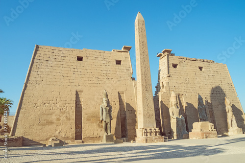Wall Murals Place of worship Standing in front of the Temple of Luxor with an obelisk and statues of Ramesses II