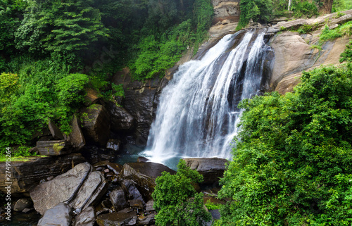 Photo  Huluganga Falls is Situated about 30 kilometers away from Kandy Town in on the way of Bambarella, in Kandy District in Sri Lanka