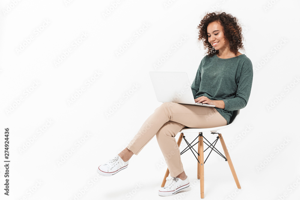 Fototapety, obrazy: Attractive young african woman sitting on a chair