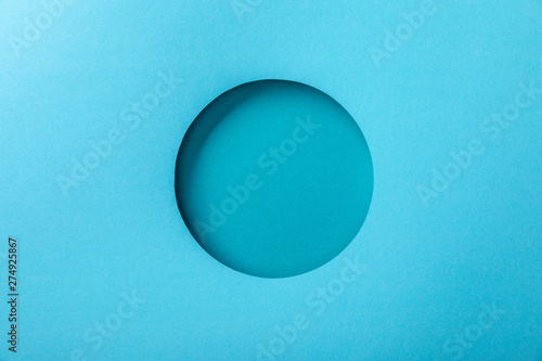 Pinturas sobre lienzo  blue paper background with minimalistic round hole