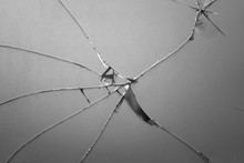 Broken Mirror Shattered In Many Pieces. Cracked Glass ,The Mirror Crack Texture Background.