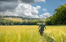 Man In A Field Of Wheat