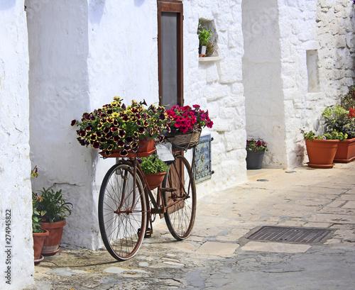 Foto op Plexiglas Fiets vélo sur le mur