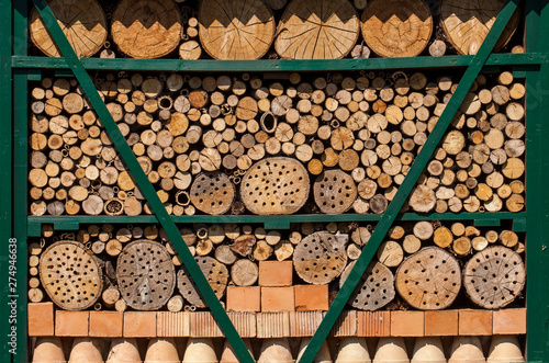Poster Firewood texture Insect house - hotel in a summer garden