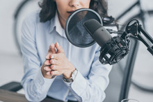 Cropped Shot Of Radio Host Speaking In Microphone In Broadcasitng Studio