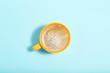 Leinwanddruck Bild - Cup of coffee on blue background. Minimalism concept