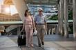 Elder couple walking on walk way of sky bridge