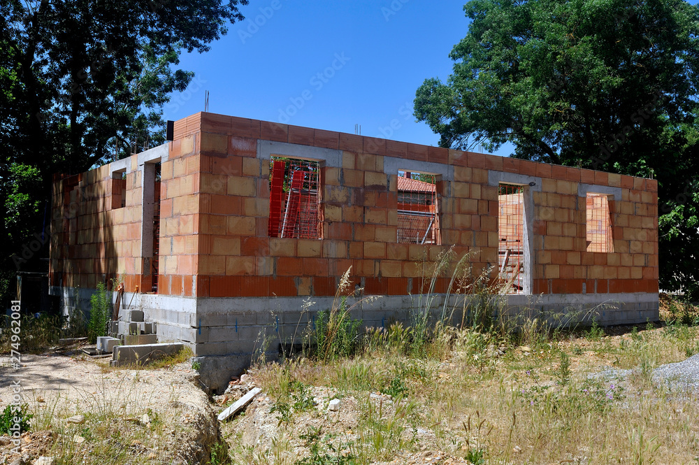 Fototapety, obrazy: Construction of a stopped and abandoned house