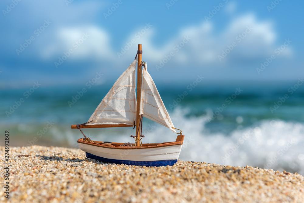 Fototapety, obrazy: Miniature fishing boat at beach