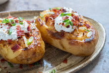 Baked Loaded Potato With Bacon...