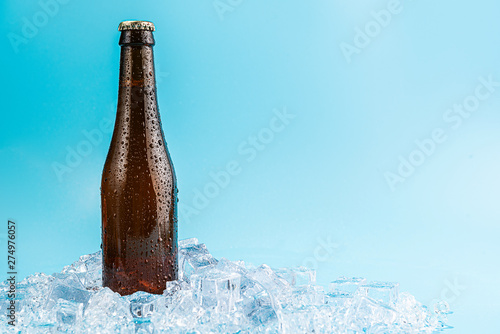 Fotografie, Obraz  closed brown glass beer bottle on ice