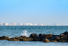 View Of Clearwater, Florida With The Waves Crashing On The Jetty