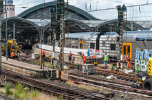 Regional Train Incoming In Station In Cologne / Germany While Workers Build New Rail Tracks