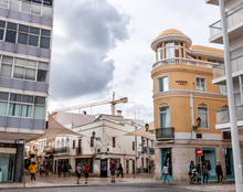 Curved Yellow Building In Faro...