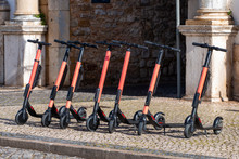 Electric Scooters In Row On Th...