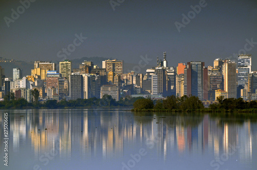 View with reflections from Guaiba River, showing buildings of Porto Alegre city, Canvas Print