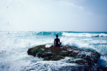Woman Practice Yoga At The Seaside Coral Cliff Edge Face The Waves