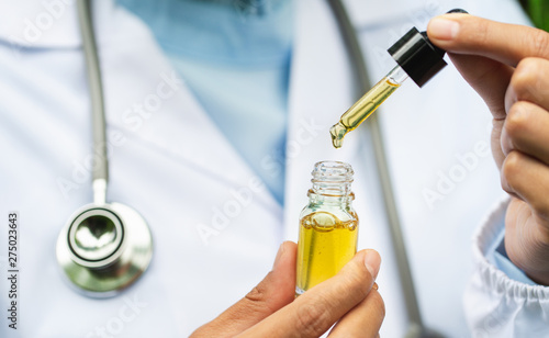 CBD Hemp oil, Doctor holding a bottle of hemp oil, Medical marijuana products in Canvas Print