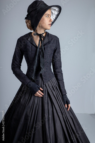 Victorian woman in black outfit Wallpaper Mural