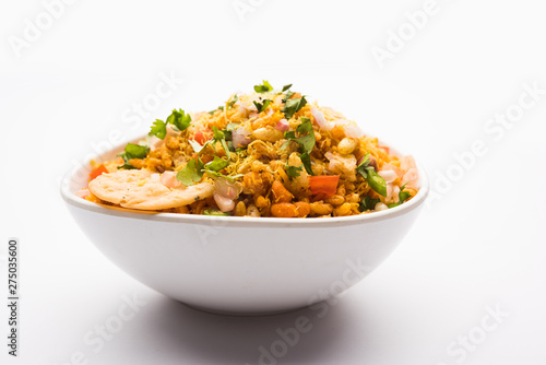 Fototapeta Bhelpuri Chaat/chat is a road side tasty food from India, served in a bowl or plate. selective focus obraz