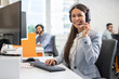 Leinwandbild Motiv Female customer support operator working in call center. Help and technical support concept.