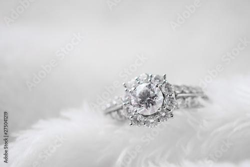 Vászonkép luxury jewelry diamond ring on white fur texture