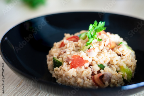 Photo  Bulgur salad with vegetables on the kitchen table with ingredients