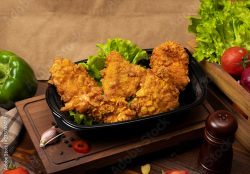 Crispy chicken drumsticks grilled kfc style with crackers.
