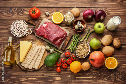 Different healthy food on wooden table - 275051877