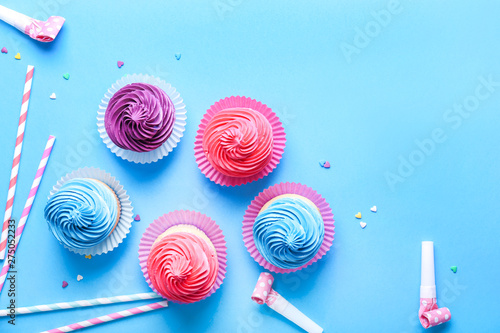 Sweet tasty cupcakes with party decor on color background Canvas Print