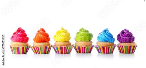 Sweet tasty cupcakes on white background Wallpaper Mural