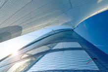 Sail Of A Catamaran Sailing Boat Against Clear Blue Sky