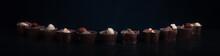Chocolate Candies On A Dark Background