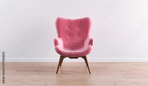 Fotografie, Obraz  Fashionable modern pink armchair with wooden legs against a white wall in the interior