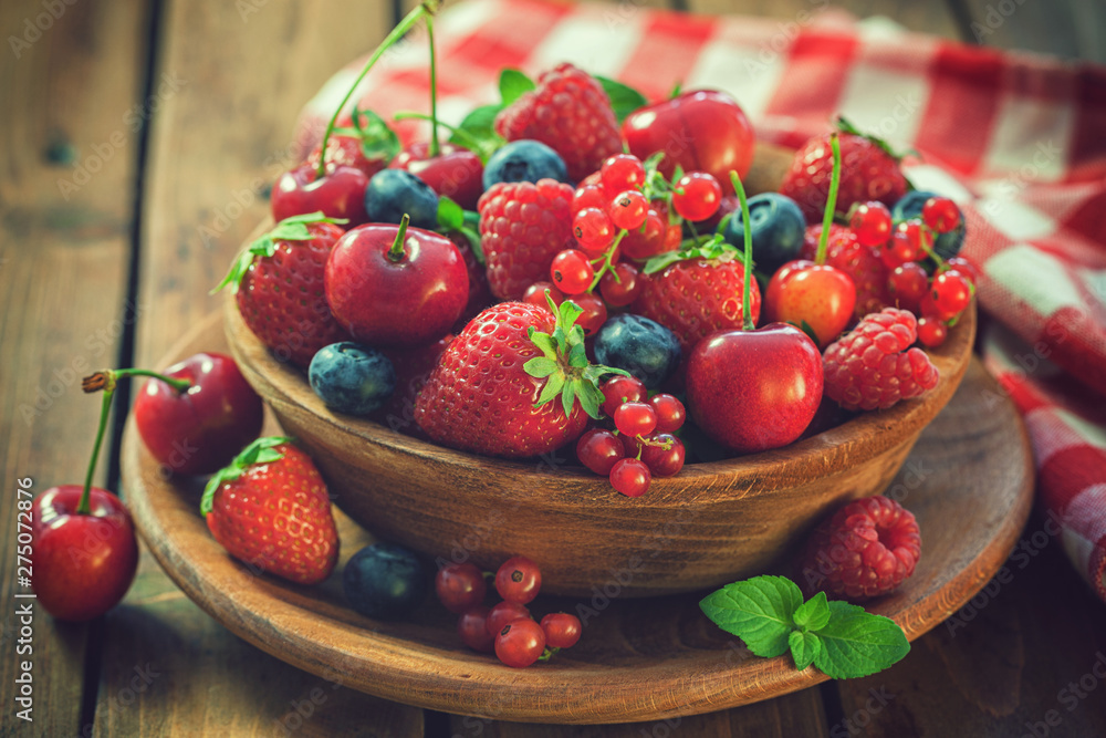Fototapety, obrazy: Fresh mixed berry fruits in wooden bowl