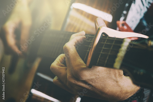 Adult Male Playing Acoustic Guitar, Vintage Picture Style Added - 275079452