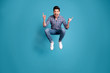 canvas print picture - Full length body size view photo charming rejoice positive cheerful youth free time holidays shout dream dreamy playful wear fashionable plaid jeans clothes legs sneakers isolated blue background